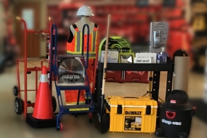 Image of industrial supplies available at Knell's showroom on Shirley Drive, Kitchener, Ontario. Picture depicts supplies such as pylons, tool boxes, saw blades, shop-vacs,, shovel, hose, construction lighting, hard-hat, hand-trucks, and first aid kit